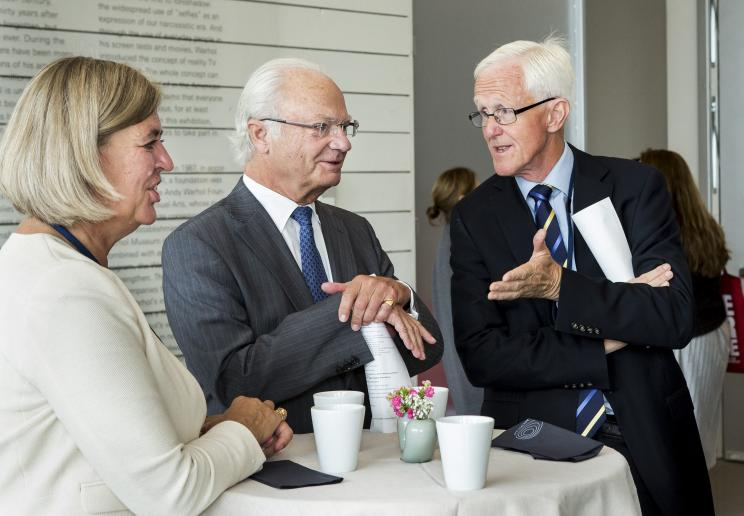 Carl XVI Gustaf King of Sweden talks to the Chair of the SIPRI Governing Board, Sven Olof-Petersson