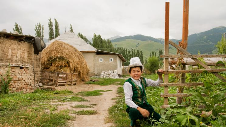 A young boy wears a traditional Kyrgyz hat in Kemin, Kyrgyzstan, 2013