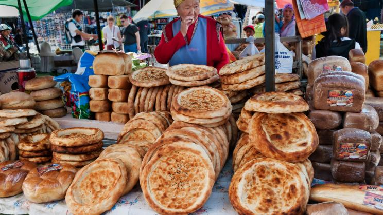 Woman selling bread in a market in Bosteri, Kyrgyzstan