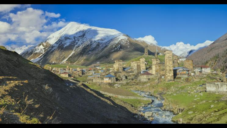 Caucasus mountains with traditional stone towers in Svaneti, Georgia.