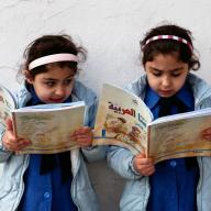 Young girls reading in Jordan. Photo: Tanya Habjouqa