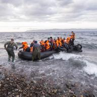 Syrian refugees arrive by boat in Greece