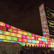 Sustianable Development Goals projected onto the UN headquarters building, 2015.